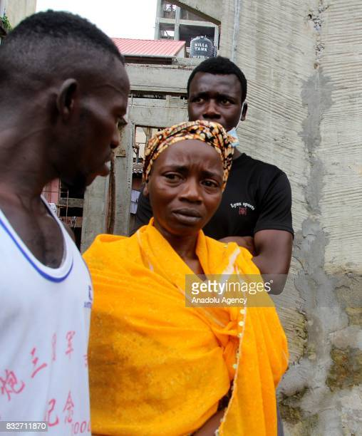A woman gets sad as people wait to identify their relatives' bodies at Connaught hospital after landslide struck the capital of the west African...