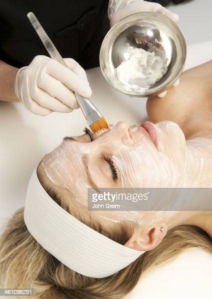 Woman getting a facial treatment at a spa