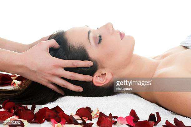 woman getting a head massage in the spa