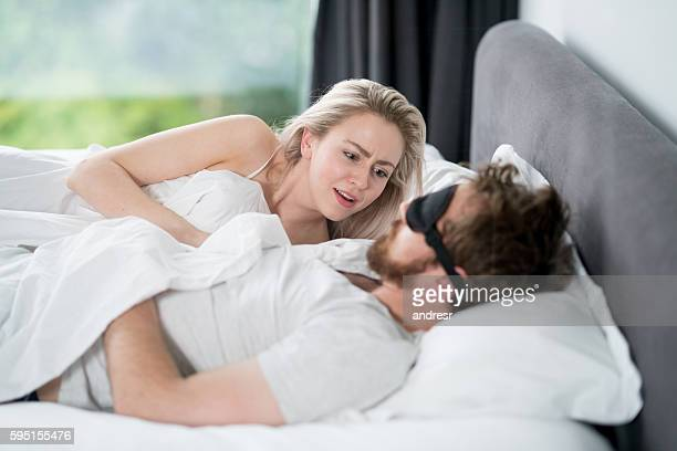 Woman getting angry at her sleeping partner