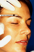 Woman getting anti-wrinkle injection