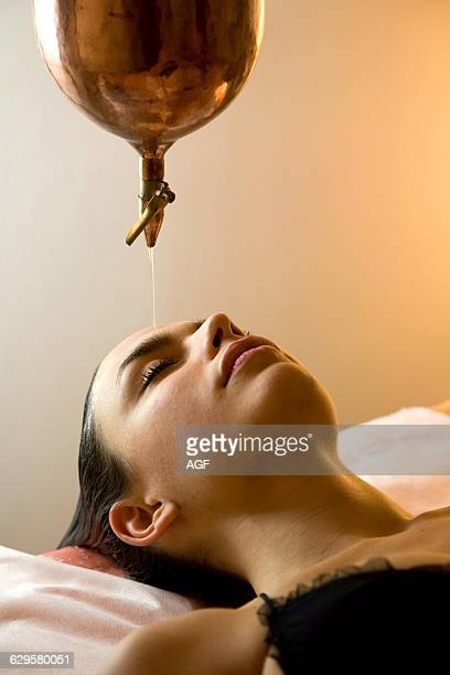 Woman Getting Ayurvedic Oil Treatment