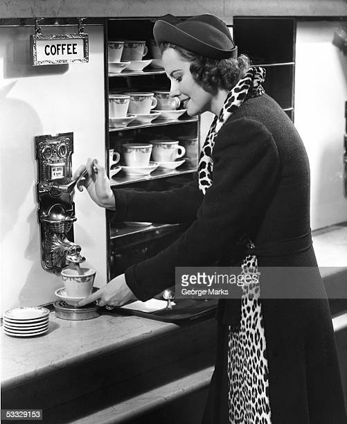 Woman getting coffee at old fashioned machine