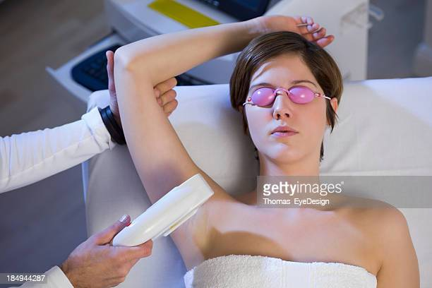 Woman Getting  Electrolysis Treatment for Under Arms