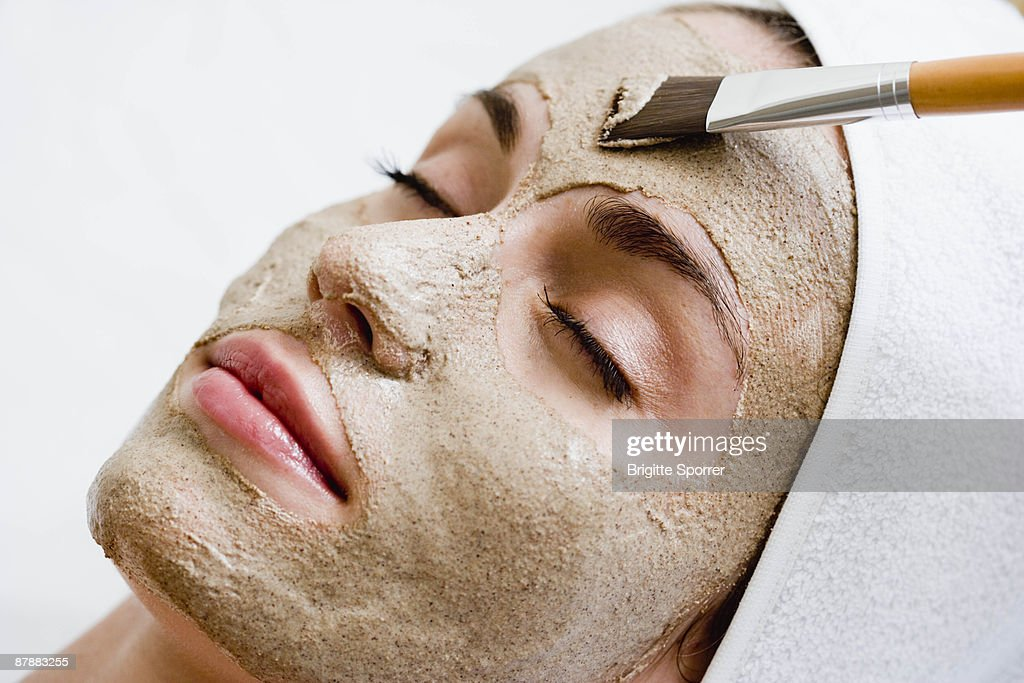 Woman getting face mask : Stock Photo