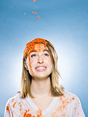 woman getting goo dumped on her head