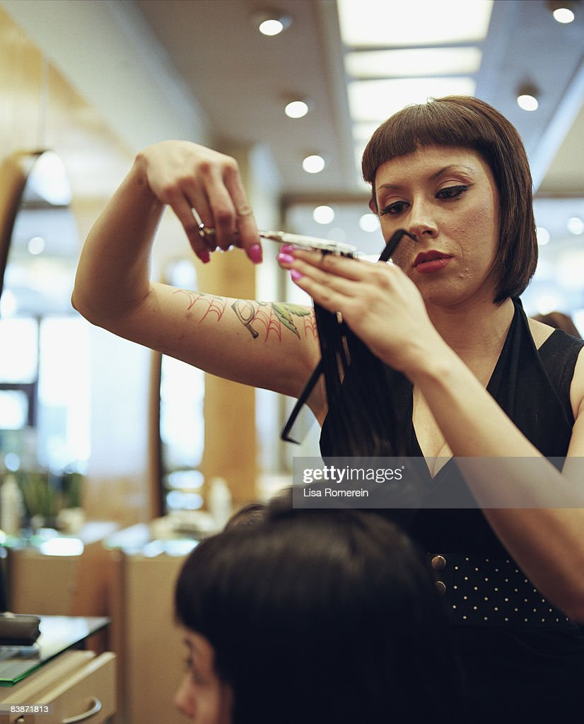 woman getting hair and make up done at salon : Stock Photo