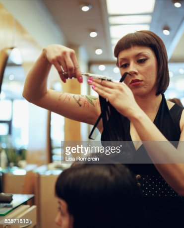 woman getting hair and make up done at salon : Stockfoto