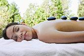 Woman getting hot stone massage