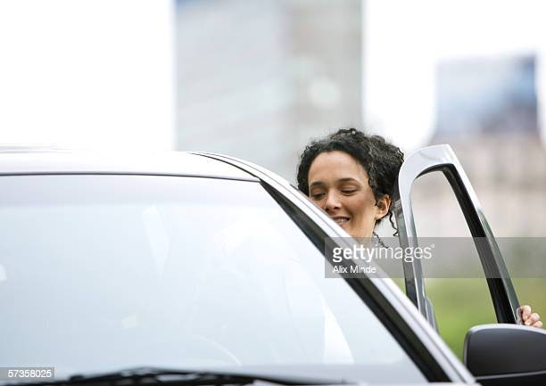 Woman getting into car