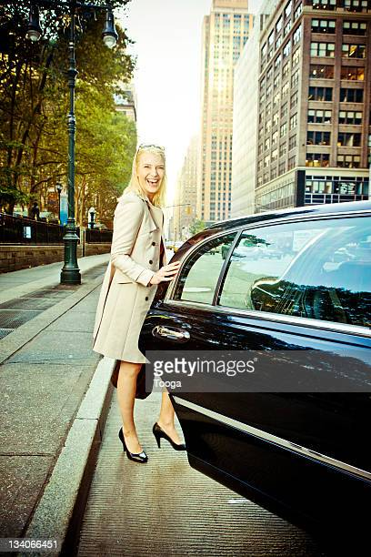 Woman getting into limousine in NYC
