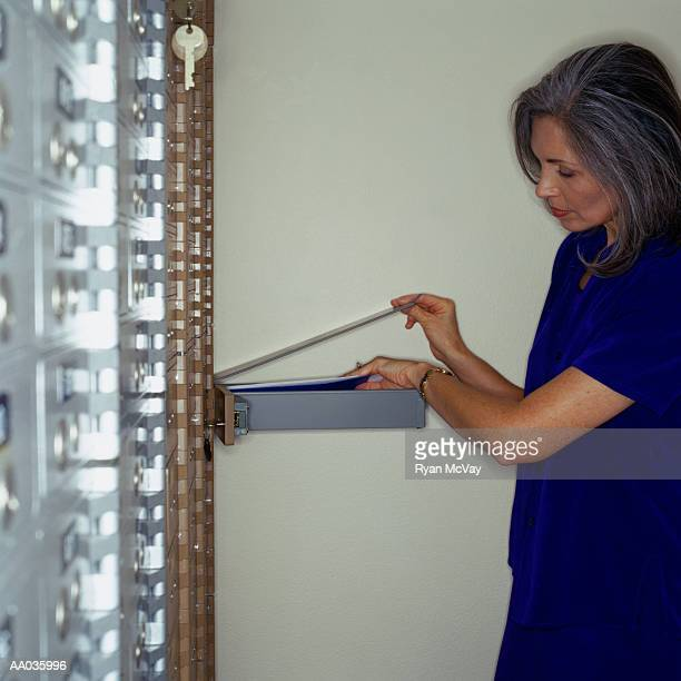 Woman Getting into Safety Deposit Box