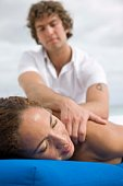 Woman getting massage outdoors