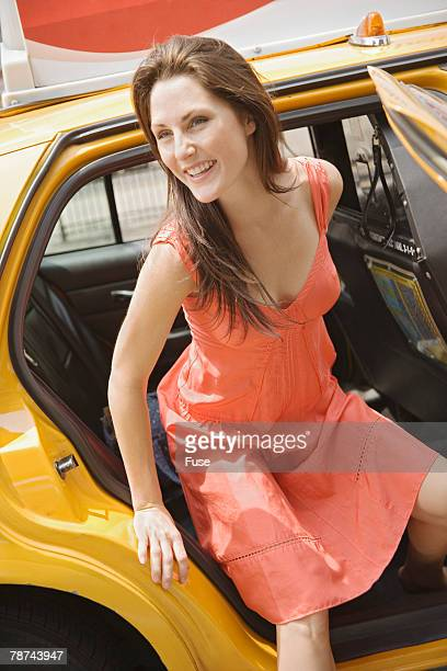 Woman Getting out of Taxi