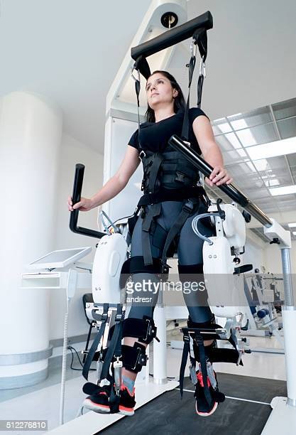 Woman getting physiotherapy on a machine