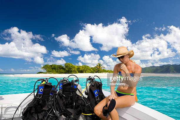 woman getting ready for a diving excursion in the Caribbean