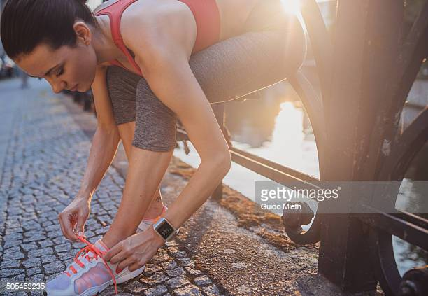 Woman getting ready for running.