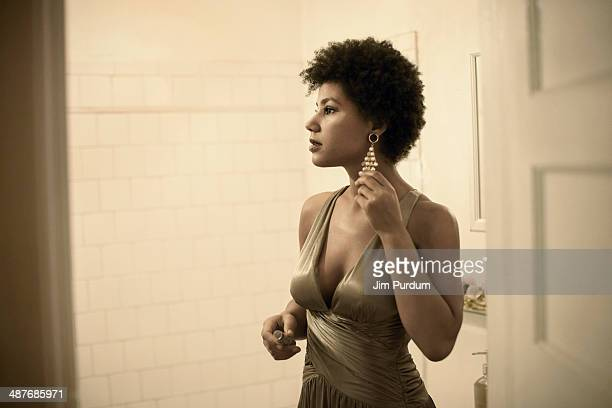 Woman getting ready in bathroom