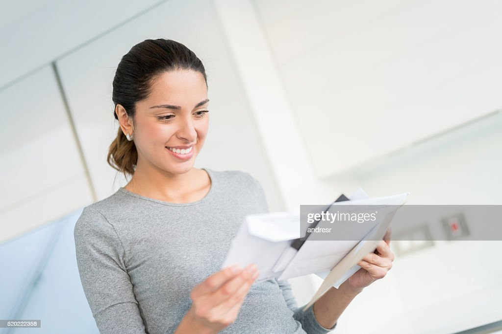 Woman getting the mail : Foto stock