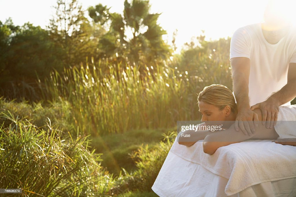 Woman Getting Therapeutic Massage Outdoors : Stock Photo