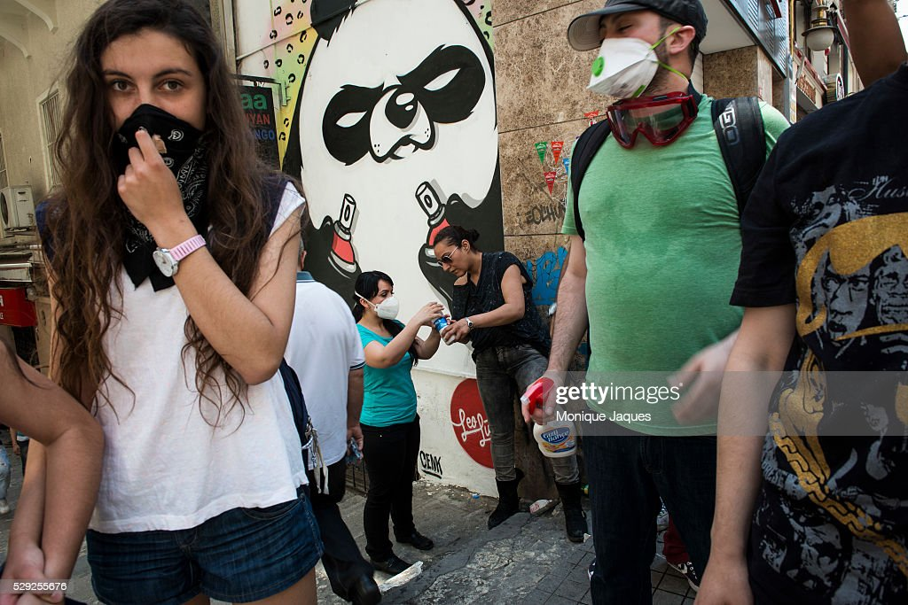A woman gives out a solution of milk and antacid that releives eyes from the sting of tear gas on Istikal Cadessi Protests in Istanbul Turkey...