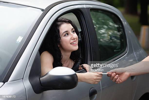 Woman gives your Driver's License for verification