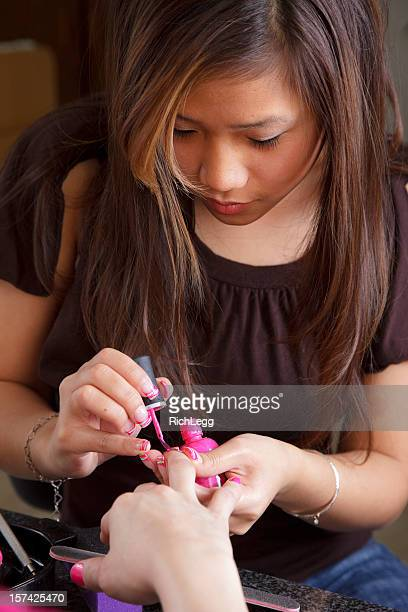 Woman Giving a Manicure