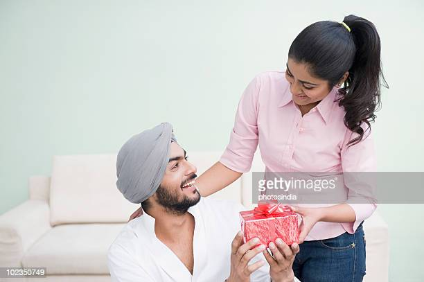 Woman giving a present to her husband