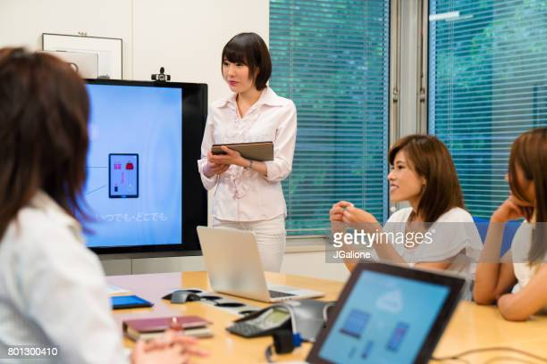 Woman giving a presentation about her cloud based mobile application