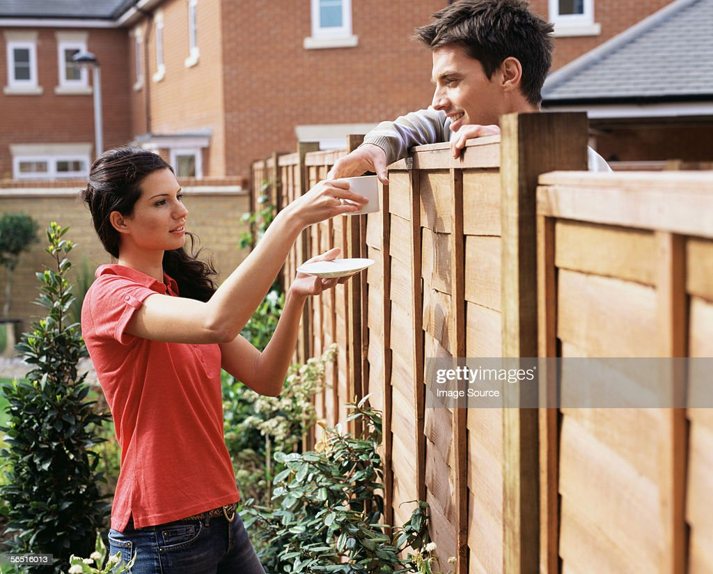 Woman giving coffee to neighbour : Stock Photo