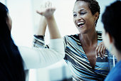 Woman giving coworker 'high 5'