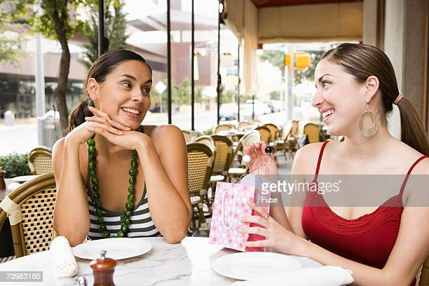 Woman giving friend a gift