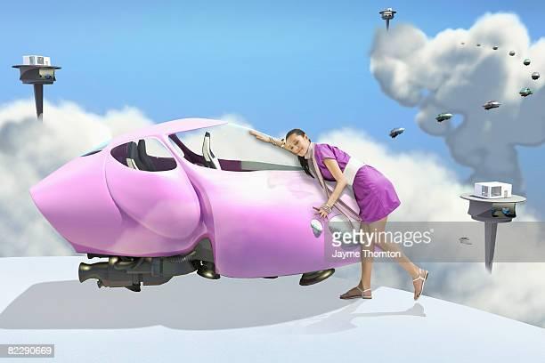 Woman giving future car a hug