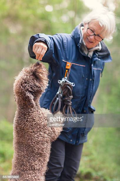 Woman giving her dog a treat