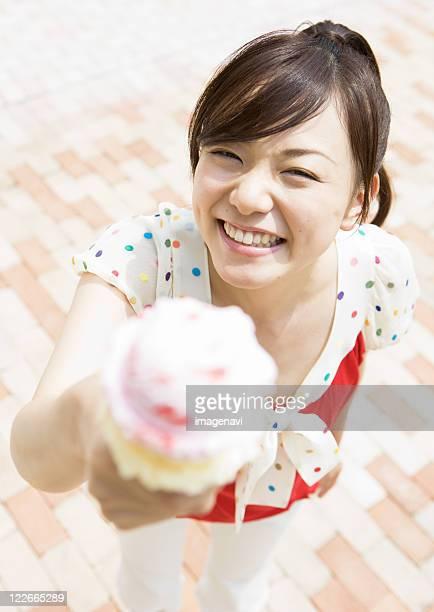 A woman giving ice cream