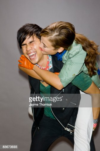 Woman giving kiss on cheek to man : Stock Photo