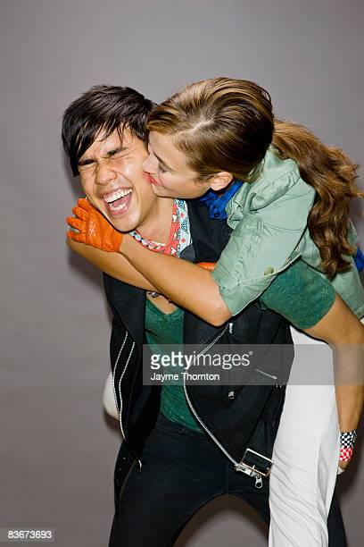 Woman giving kiss on cheek to man