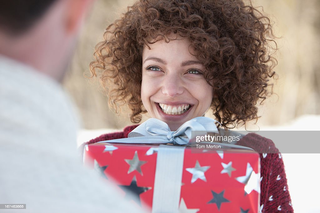 Woman giving man gift : Stock Photo