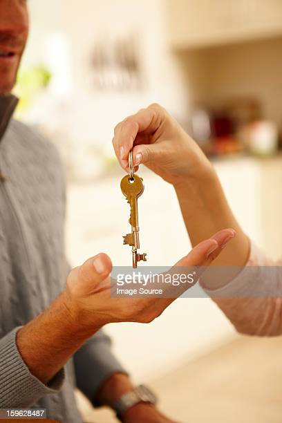 Woman giving man house key