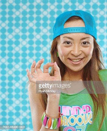 Woman giving 'OK' sign : Stock Photo