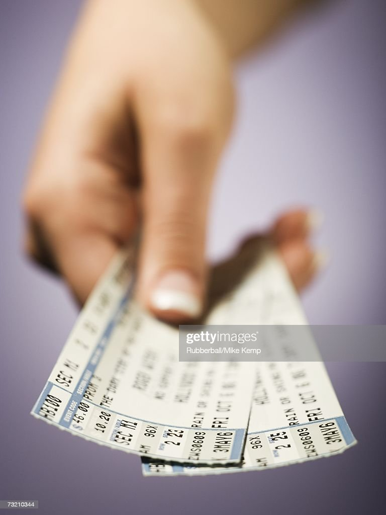 Woman giving tickets : Stock Photo