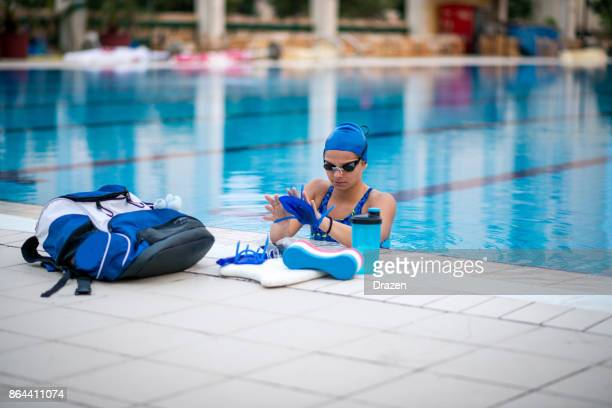 Woman goes snorkeling and swimming in swimming pool