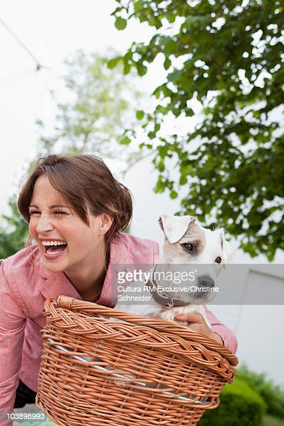 Woman going for bike ride with dog