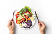 Cropped image of woman going to eat salad isolated on white