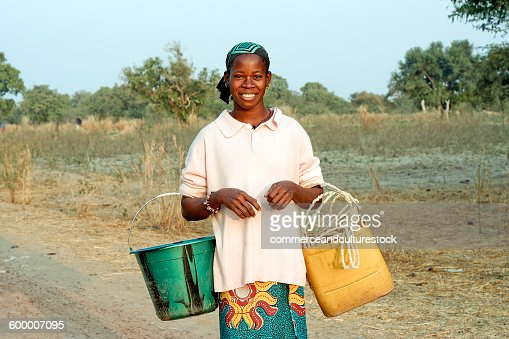 A woman going to fetch water in a creek