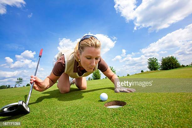 Woman Golfer cheating