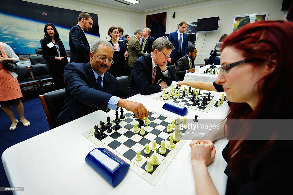 Woman Grandmaster Jennifer Shahade (R) shares chess tips with Rep. <a gi-track='captionPersonalityLinkClicked' href=/galleries/search?phrase=Chaka+Fattah&family=editorial&specificpeople=753131 ng-click='$event.stopPropagation()'>Chaka Fattah</a> (D-PA) during a special event held at United States Capitol Building on April 18, 2013 in Washington, DC.