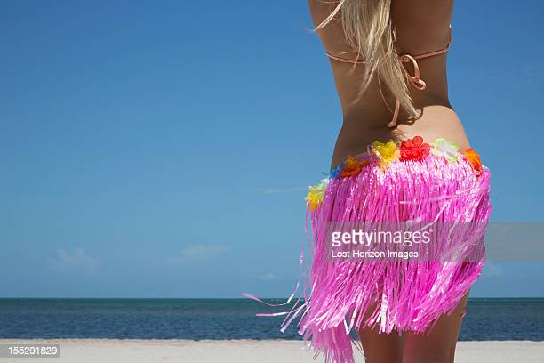 Woman grass skirt on beach