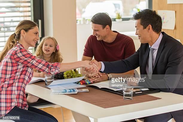 Woman greeting male financial advisor