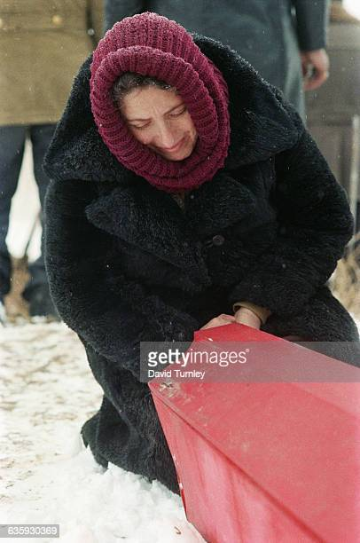 A woman grieves over the coffin containing the body of Tegran Abgarzian a 17yearold earthquake victim Nearly two thirds of those killed were children...